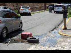 Overflowing sewage at the intersection of East Street and Sutton Street in Kingston is affecting vendors and other persons.