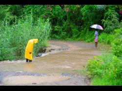 Residents have to contend with this rushing water whenever there is steady rainfall.