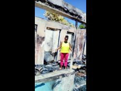Antoinette Chambers stands in what is left of her home.