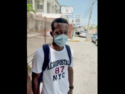 Farm worker Richard Roye outside the East Street offices of the Ministry of Labour and Social Secuity in Kingston, shortly after taking his COVID-19 test yesterday.