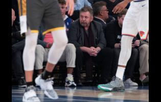 In this March 6, 2020, file photo, New York Knicks owner James Dolan (centre) watches the first half of an NBA basketball game between the Knicks and the Oklahoma City Thunder at Madison Square Garden in New York. Dolan, the executive chairman of Madison Square Garden Company and owner of the Knicks, has tested positive for the coronavirus.