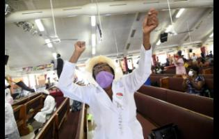 A worshipper at the Power of Faith Ministries church in Portmore, St Catherine.