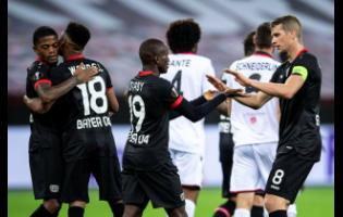 Leverkusen's Leon Bailey, Wendel, goalscorer Moussa Diaby and Lars Bender (from left) cheer after the goal for the 3:1 during the Europa League Group C match between Bayer Leverkusen and OGC Nice in Leverkusen, Germany, yesterday.