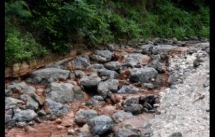 The main road to Bito/Bloxburgh has been destroyed, cutting off the rural St Andrew communities. The residents have resorted to walking an estimated two and a half miles to Cane River to get a taxi to get to Bull Bay to purchase food supplies.