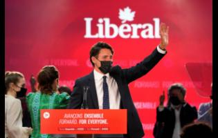 Liberal Leader Justin Trudeau greets supporters prior to his victory speech at party campaign headquarters in Montreal, Canada, yesterday.