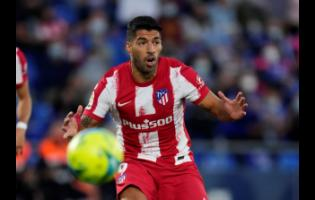 Atletico Madrid's Luis Suarez waits to receive a pass during the Spanish La Liga match against Getafe at the Coliseum Alfonso Perez stadium in Getafe yesterday.