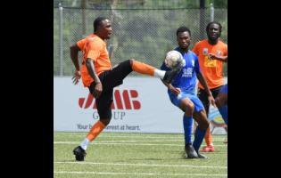 Jermaine Johnson (left) of Tivoli Gardens controls the ball during a Jamaica Premier League match against Molynes United on September 11.