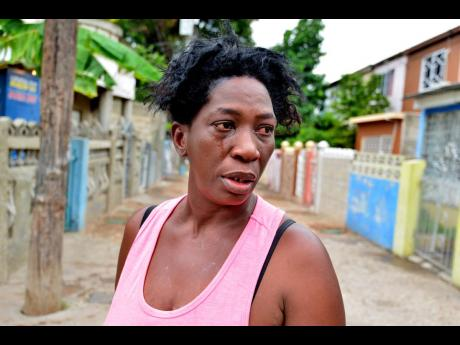 Marjorie Hinds cries as she remembers the events in Tivoli Gardens which left her spouse dead and her right arm crippled.