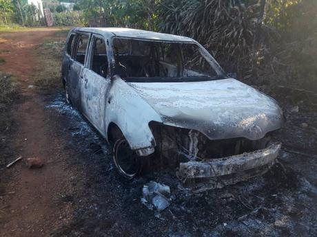 Angry residents burnt this motor car after Glester White Sr was killed, allegedly by a cop in the community yesterday.