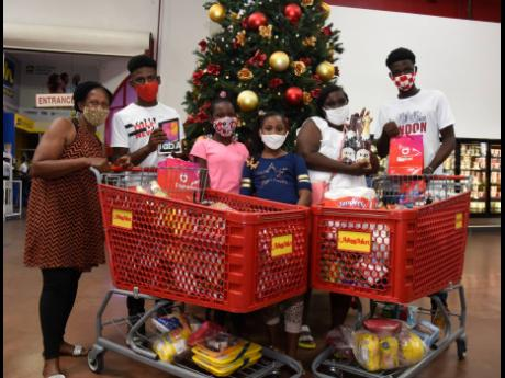 The family (from left) Petrona Anderson, Jalil Bundy, Tussanne Smart, Brittania Bundy, Marsha Smart and Tussan Smart take a  break from shopping.