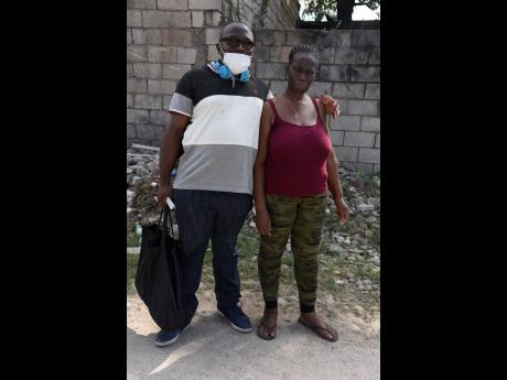Damion Rose (who is blind) and his girlfriend, Charmaine Tucker were seen in Duhaney Park, St Andrew, yesterday.