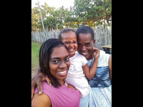 Latina Bromfield-Robinson (left) with her husband Dave and their daughter Rhizuri.