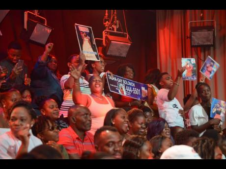 Members of the audience cheer on their favourite at the season finale of the 2018 Digicel Rising Stars. The live audience will not be around for this year's edition of the competition.