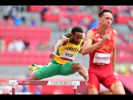 Jamaica's Jaheel Hyde clears a hurdle during the men's 400m hurdles heats at the Tokyo Olympic Games on Friday (last night Ja time). Hyde won his heat in 48.54 seconds.