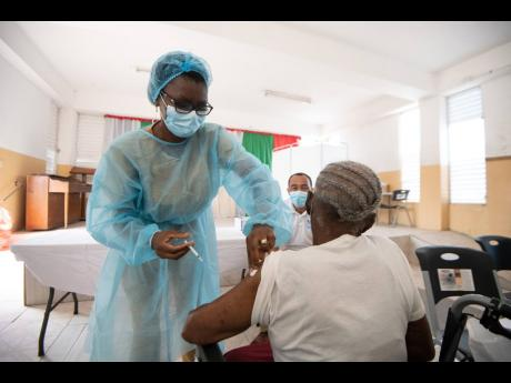 A senior citizen being vaccinated against COVID-19.
