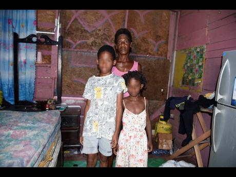 Jasmine Gillepsie and two of her children,  Kobe Dixon (left) and Kimona Grant. The children have not attended school since the pandemic.