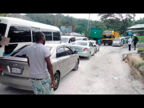 Dozens of St James taxi operators withdrew their service yesterday to protest poor road conditions.
